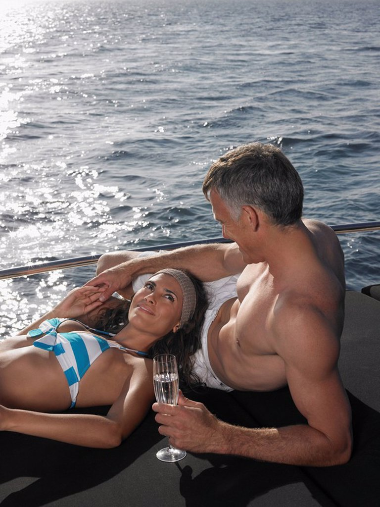 Couple Sunbathing on Boat : Stock Photo