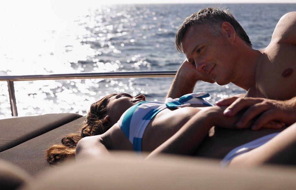 Couple Sunbathing on Boat : Stock Photo