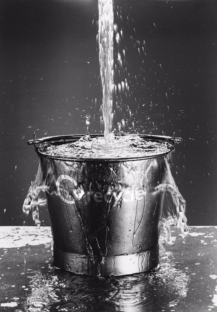 Stock Photo: 1654R-22825 Water Pouring in Bucket