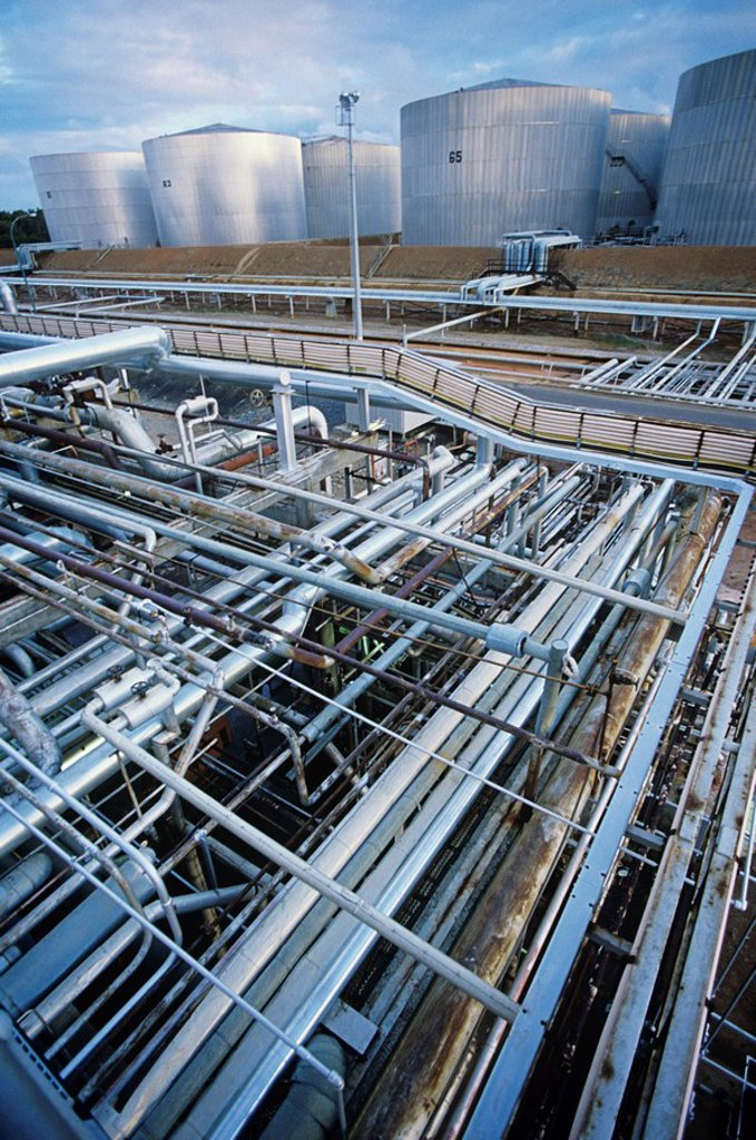 Stock Photo: 1654R-23202 Petrochemical oil refinery storage tanks and pipes