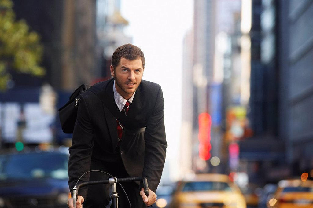 Man riding bicycle on street : Stock Photo