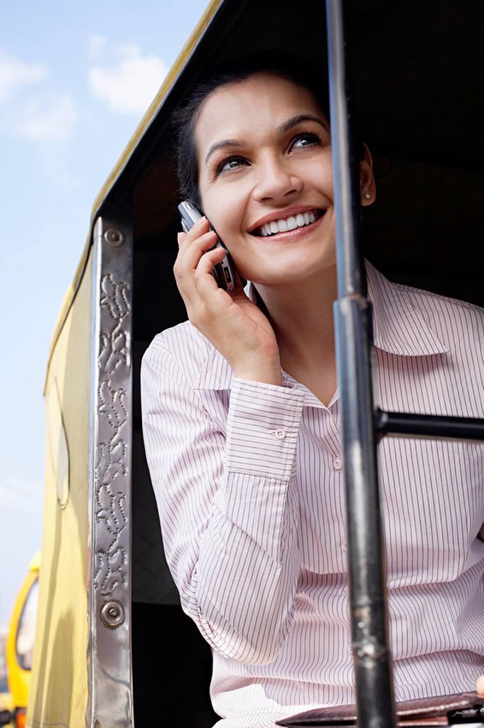 Business woman on cell phone smiling : Stock Photo