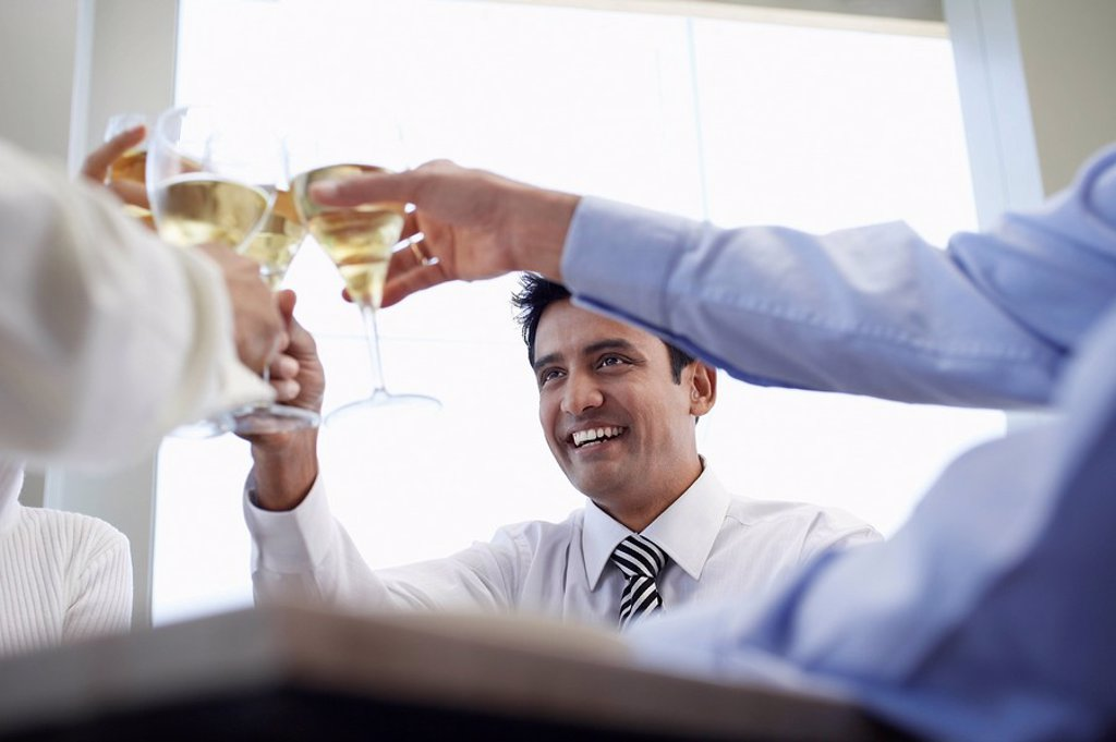Business associates toasting with wine glasses close_up : Stock Photo