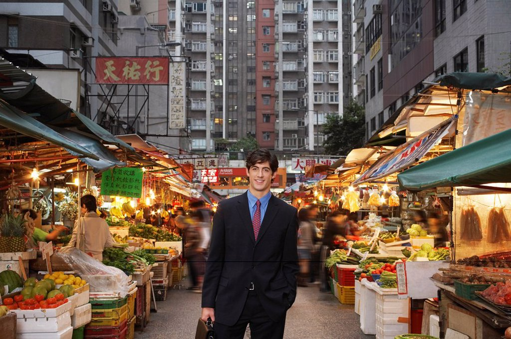 Stock Photo: 1654R-24563 Portrait of young business man at street market