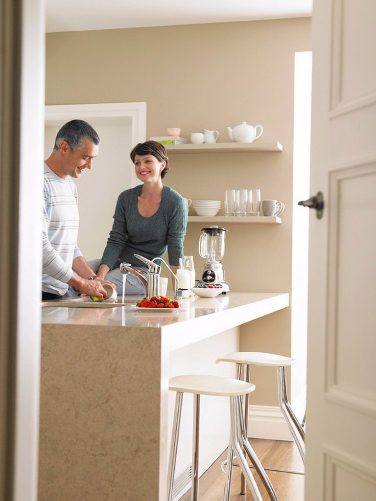 Married Couple in Kitchen : Stock Photo