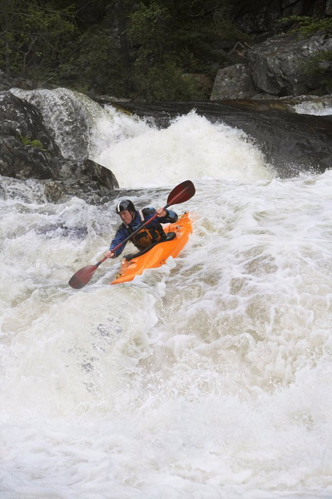 Man kayaking in river : Stock Photo