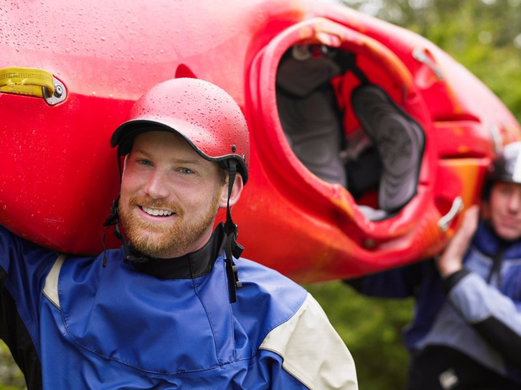 Stock Photo: 1654R-25835 Two men carrying kayak outdoors portrait