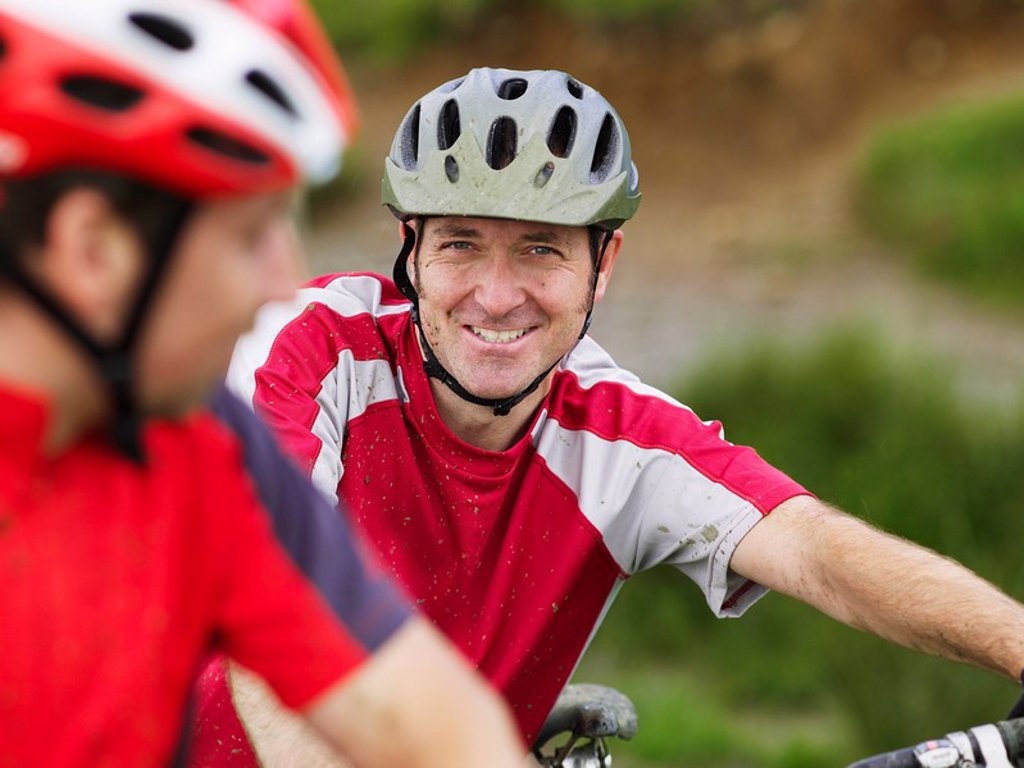 Two cyclists outdoors portrait : Stock Photo