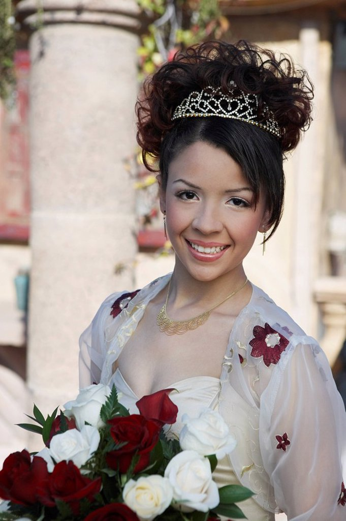 Girl 13_15 with bouquet at Quinceanera portrait : Stock Photo