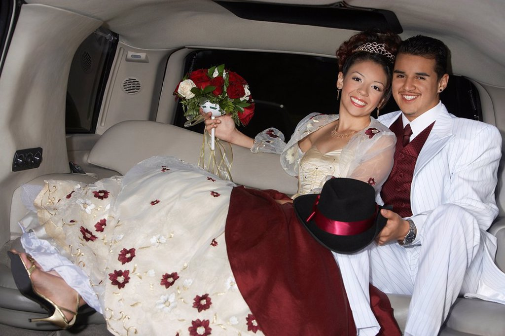 Stock Photo: 1654R-26619 Girl and boy 13_15 in limousine at Quinceanera