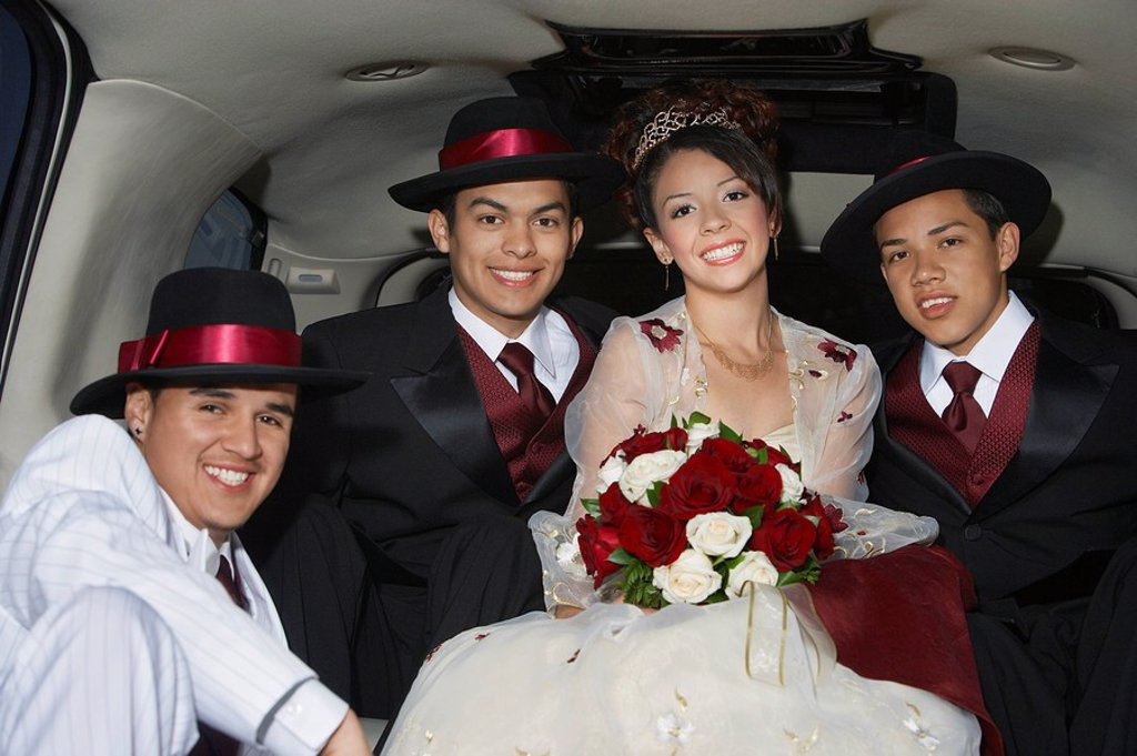Girl and boys 13_15 in limousine at Quinceanera : Stock Photo