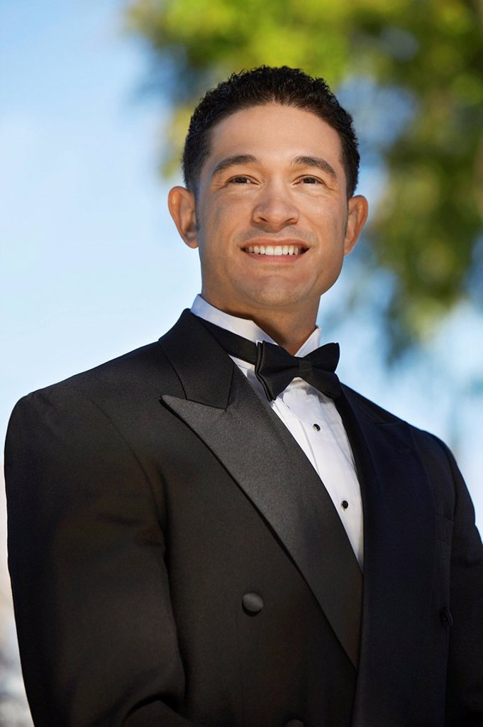 Portrait of boy 13_15 in tuxedo at Quinceanera : Stock Photo