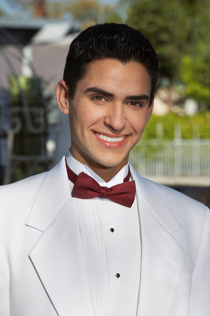 Stock Photo: 1654R-26625 Portrait of boy 13_15 in tuxedo at Quinceanera