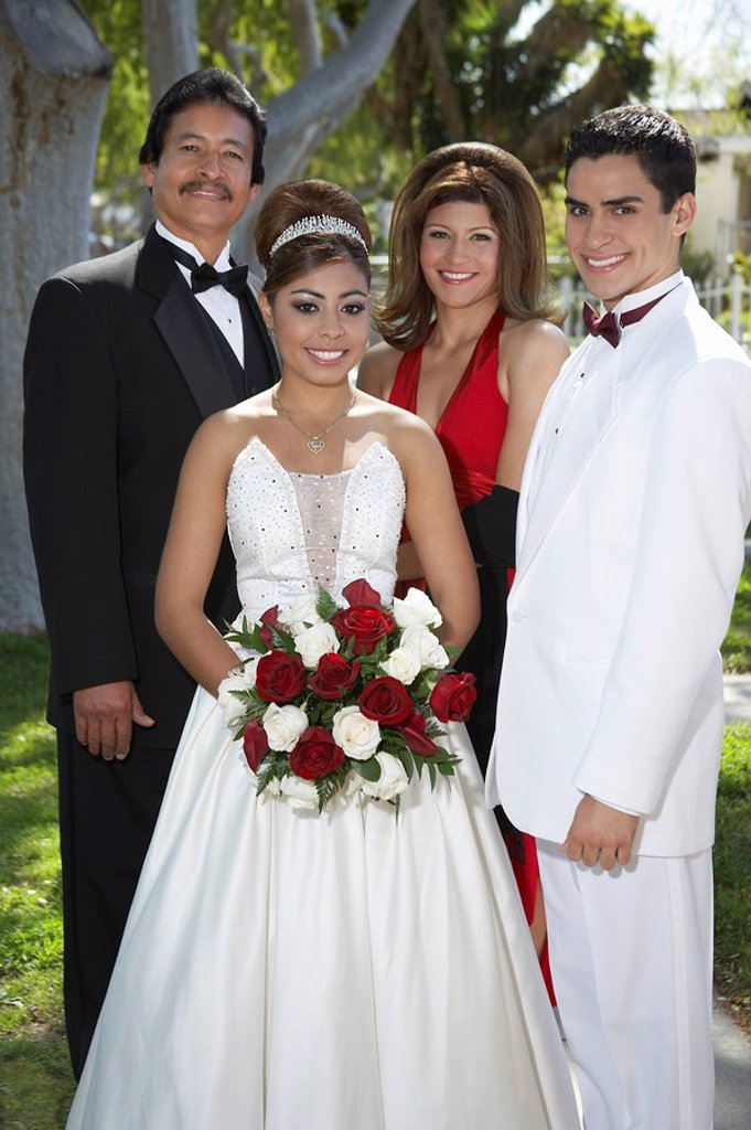 Portrait of couple 13_15 with parents at Quinceanera : Stock Photo