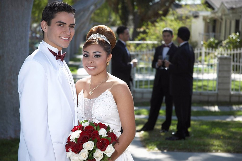Stock Photo: 1654R-26643 Portrait of couple 13_15 in garden at Quinceanera