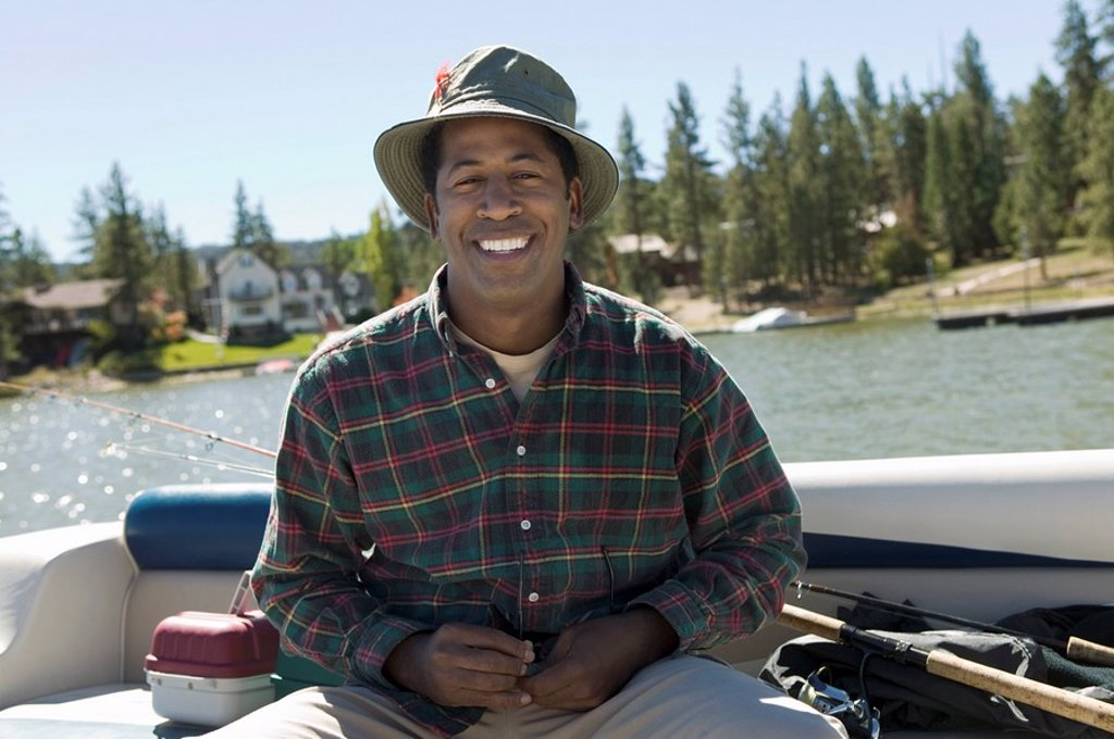 Stock Photo: 1654R-2681 Man fly fishing on lake portrait