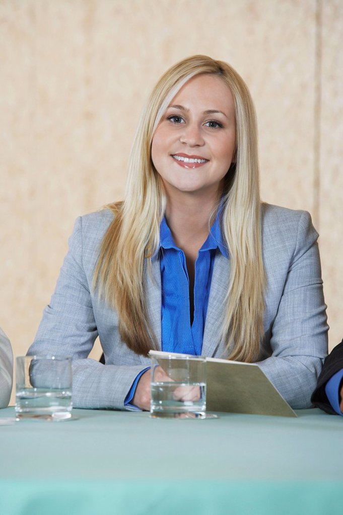 Business woman smiling in conference portrait : Stock Photo