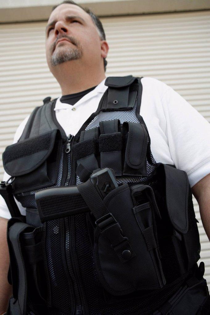 Portrait of security guard in bulletproof vest : Stock Photo