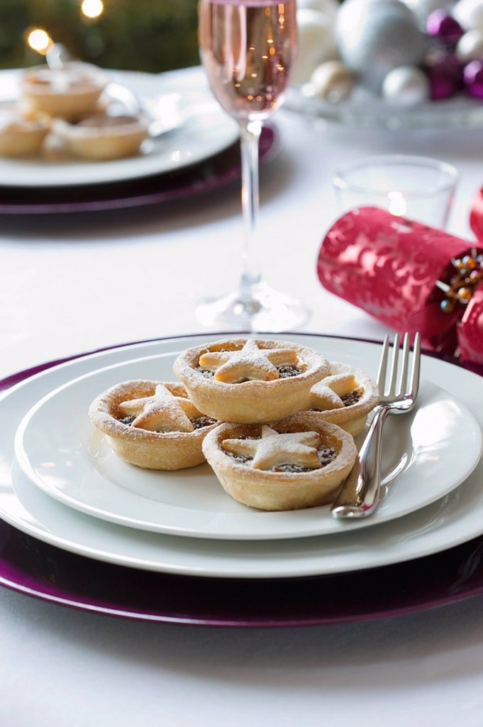 Mince pies on plate on dining table : Stock Photo