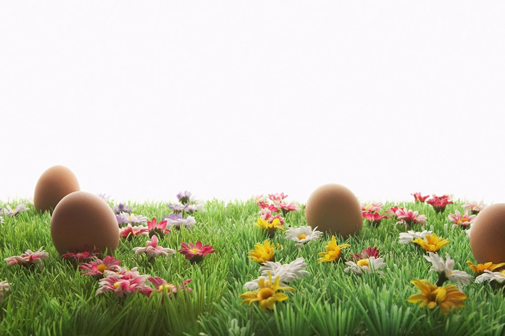 Easter eggs on artificial meadow : Stock Photo