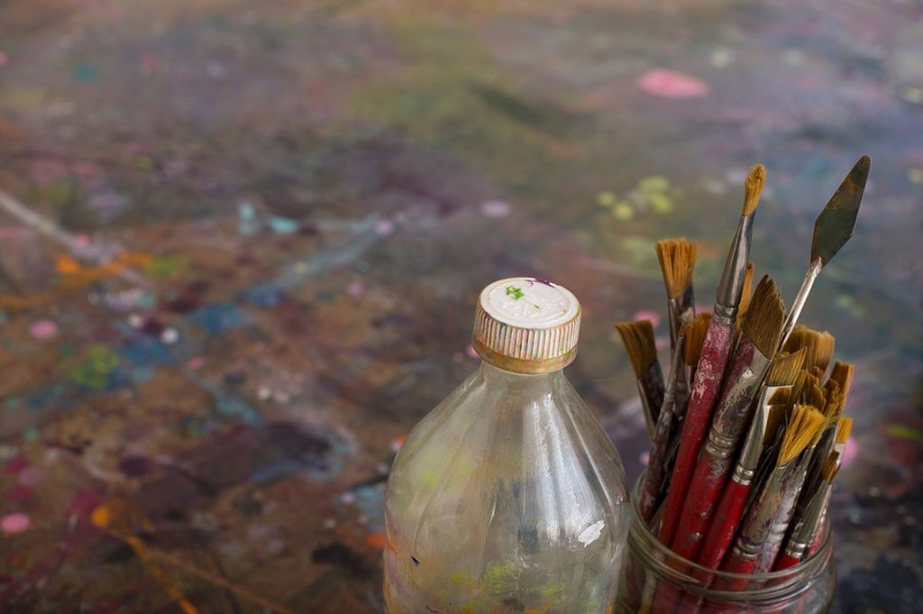 Artist´s Paint Brushes and Bottle by Palette : Stock Photo