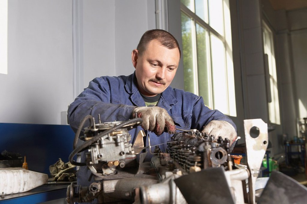 Stock Photo: 1654R-30270 Mechanic Working on Motor
