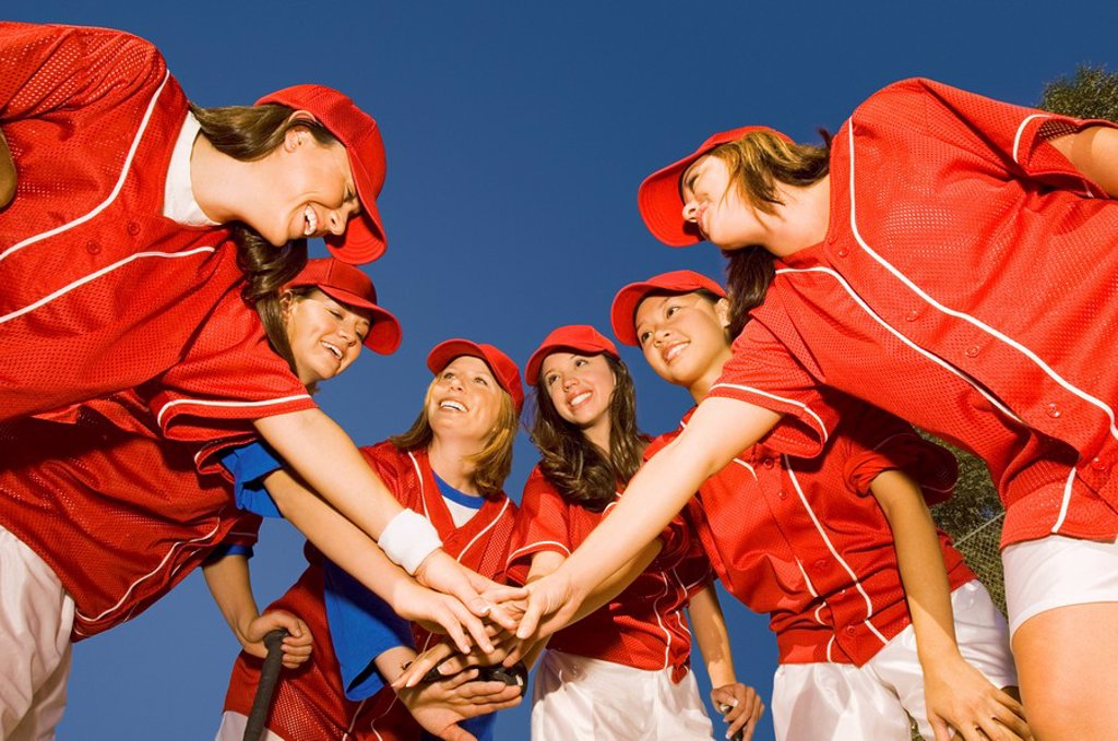 Women´s softball team in huddle low angle view : Stock Photo