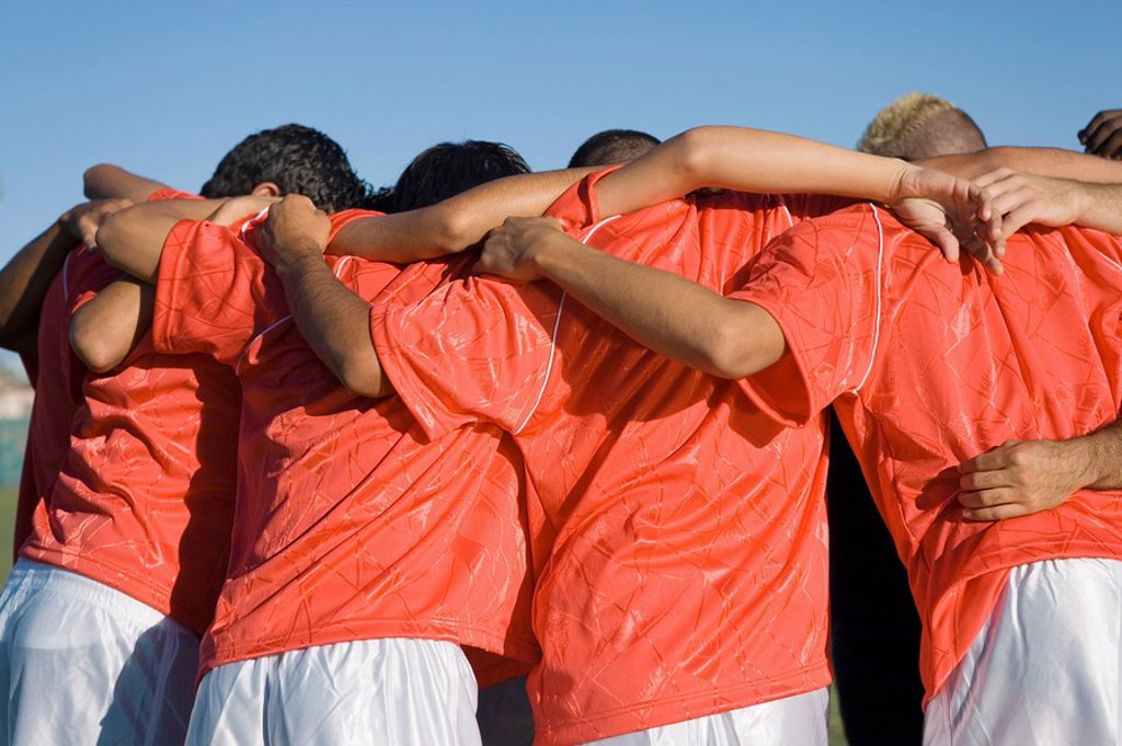 Soccer team in huddle back view : Stock Photo