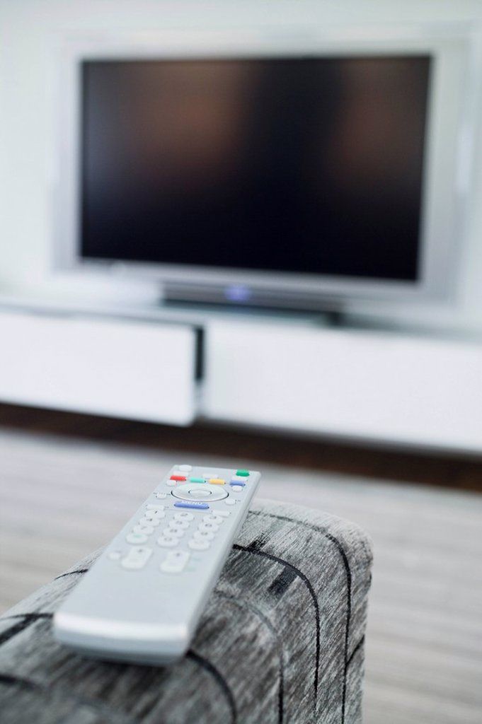 Remote control and television set : Stock Photo