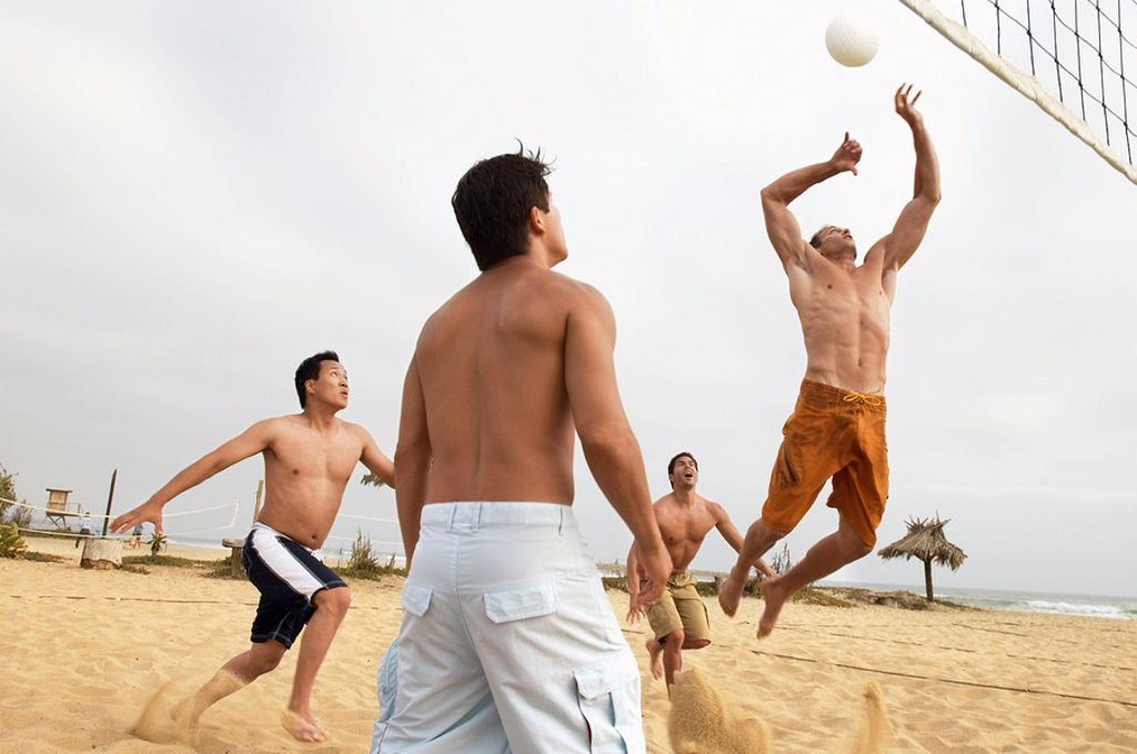 Men Playing Volleyball on beach : Stock Photo