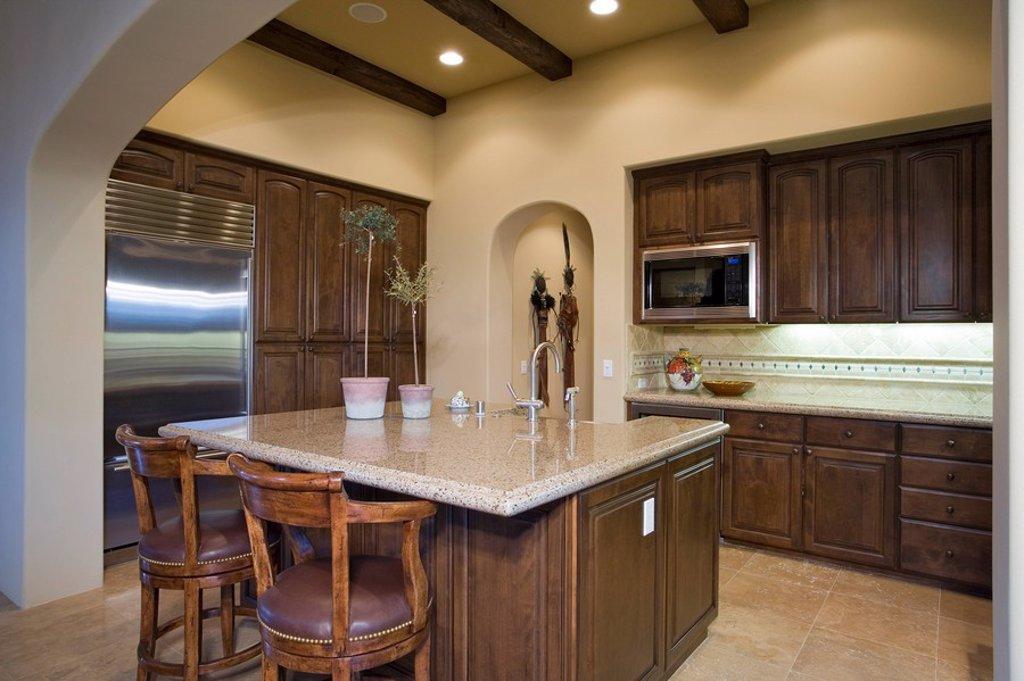 Stock Photo: 1654R-32978 Illuminated kitchen in residence