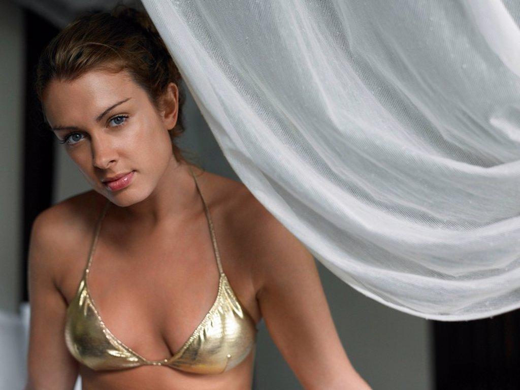 Young Woman in Bikini by Curtain : Stock Photo