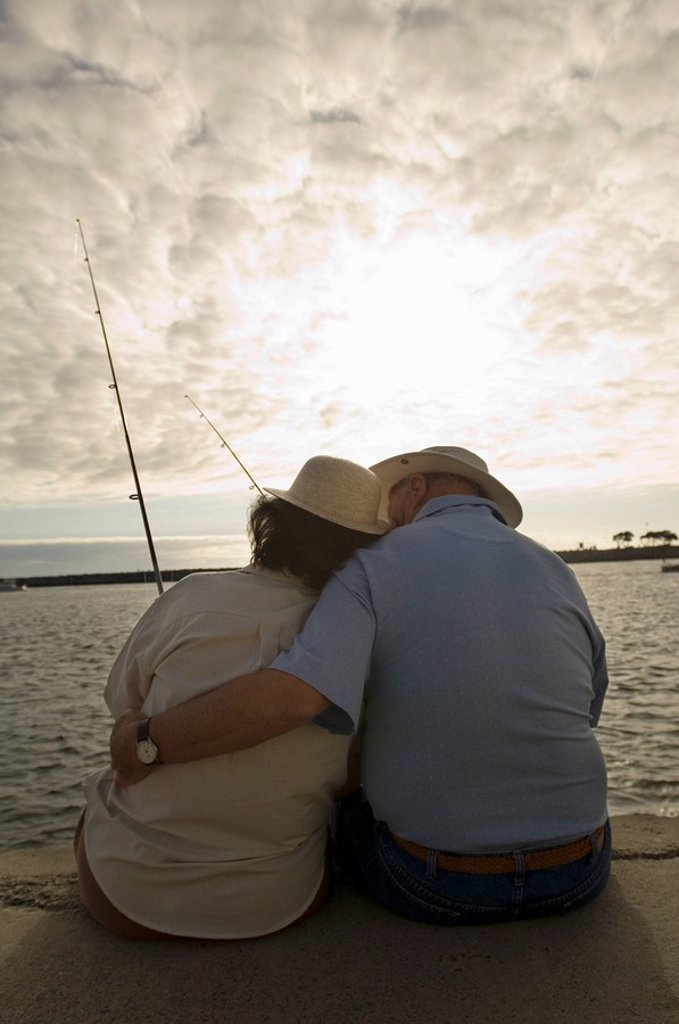 Senior couple fishing at ocean : Stock Photo