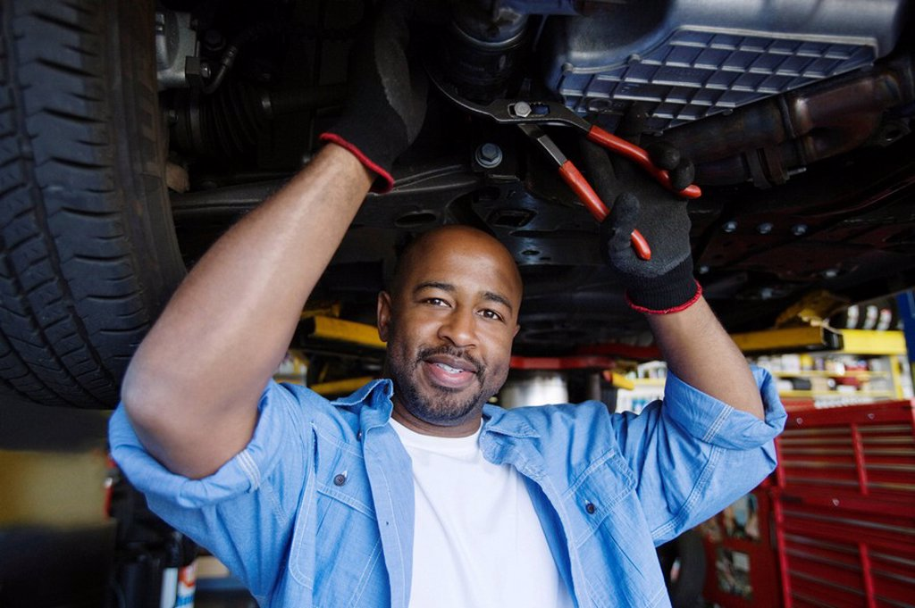 Stock Photo: 1654R-39571 Auto Mechanic Beneath a Car