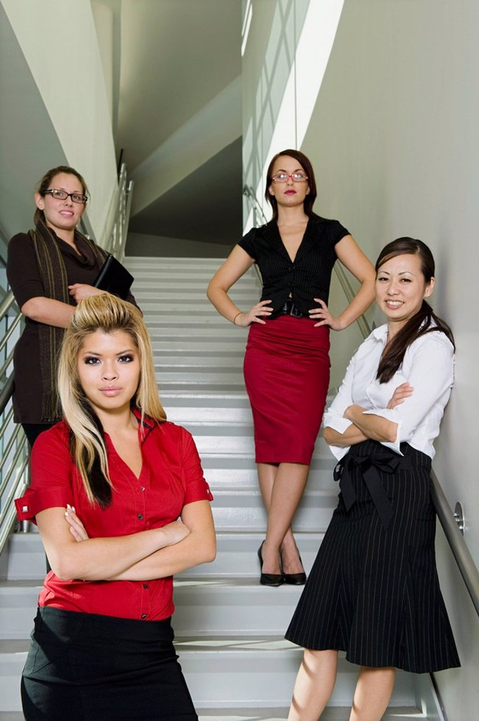 Group of Serious Businesswoman on Stairs Low Angle : Stock Photo