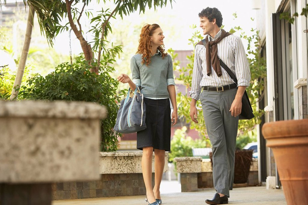 Young couple walking in courtyard : Stock Photo