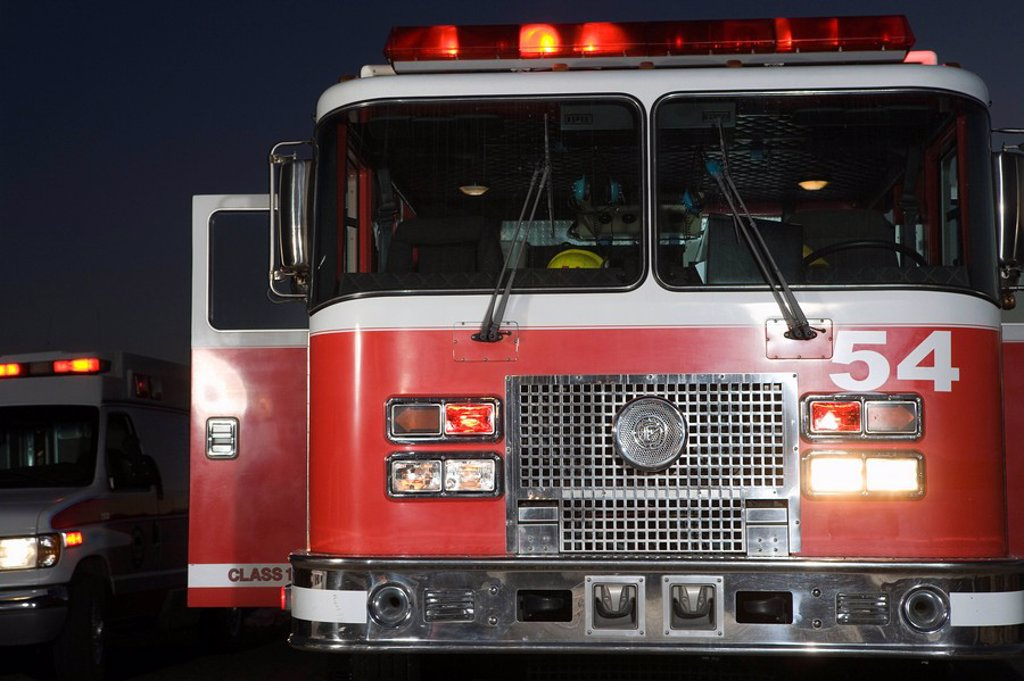 Stock Photo: 1654R-43720 Fire engine and ambulance at night