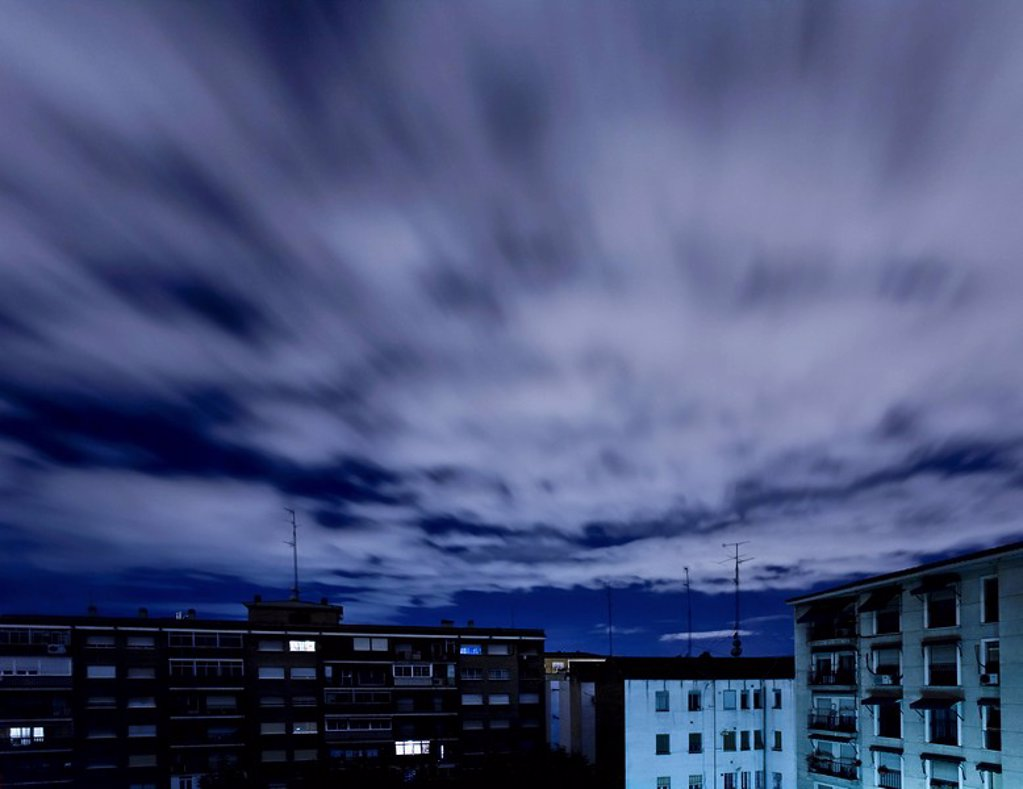 Quickening sky over city buildings : Stock Photo