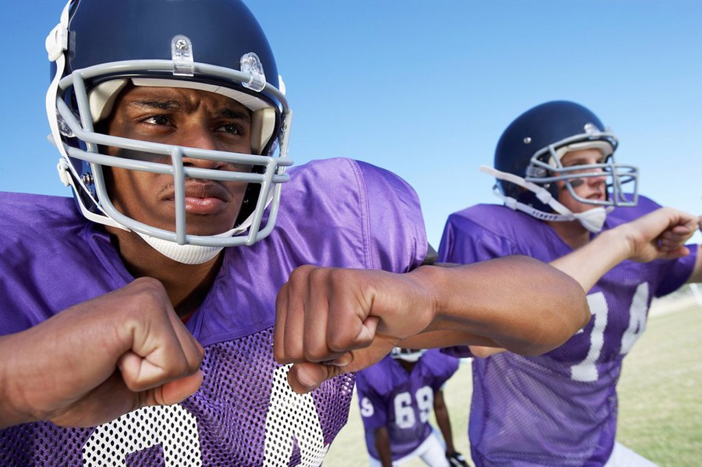 Stock Photo: 1654R-4494 Two Football Players clenching fists on field close_up close_up