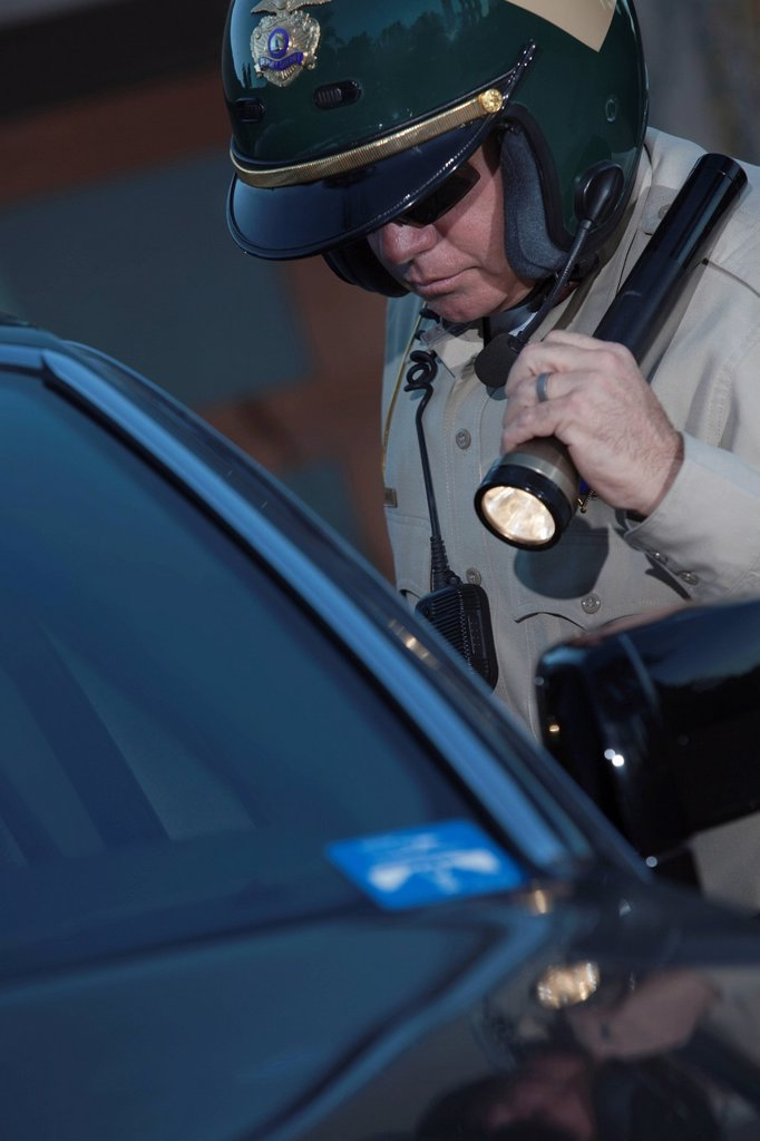 Stock Photo: 1654R-46276 Nightwatch patrolman with flashlight