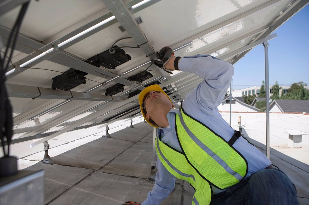 Stock Photo: 1654R-46517 Maintenance worker adjusting solar panel in Los Angeles California