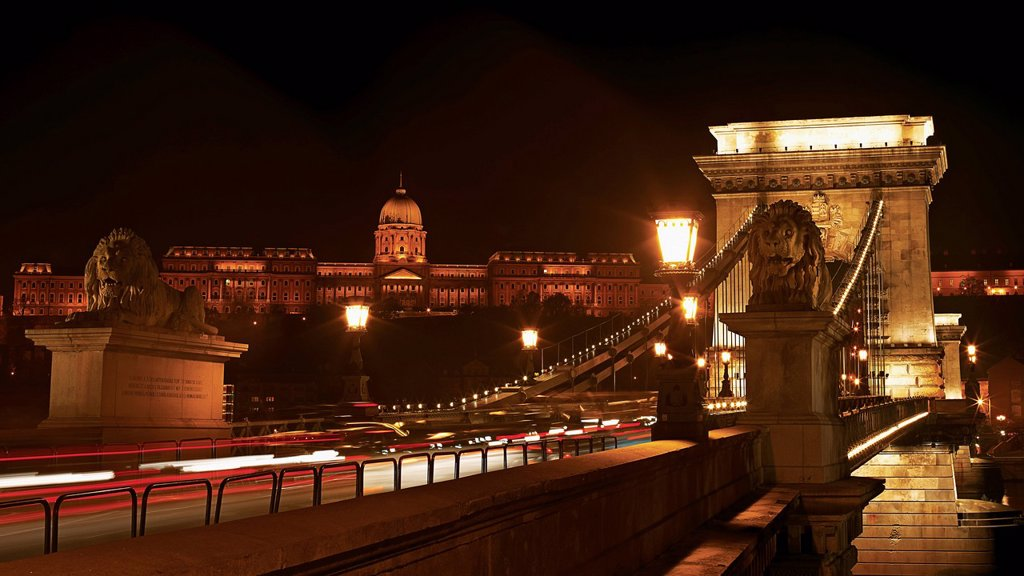 Night cityscape of the Chain bridge across the river Danube with the Buda castle in the background in the Hungarian capital Budapest : Stock Photo