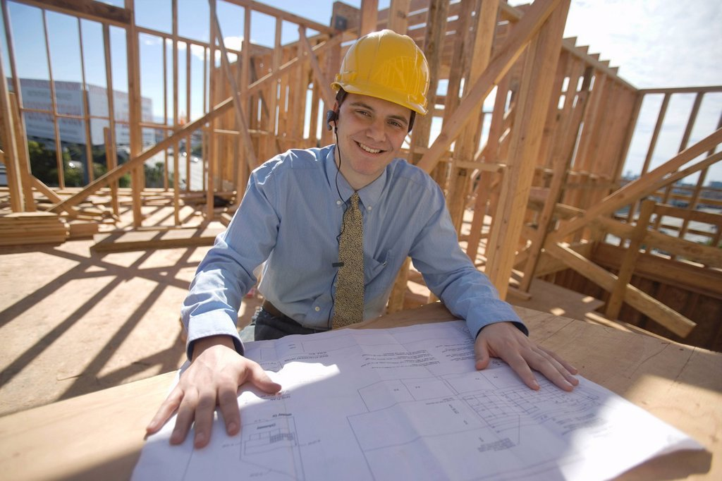 Site manager with building plans : Stock Photo