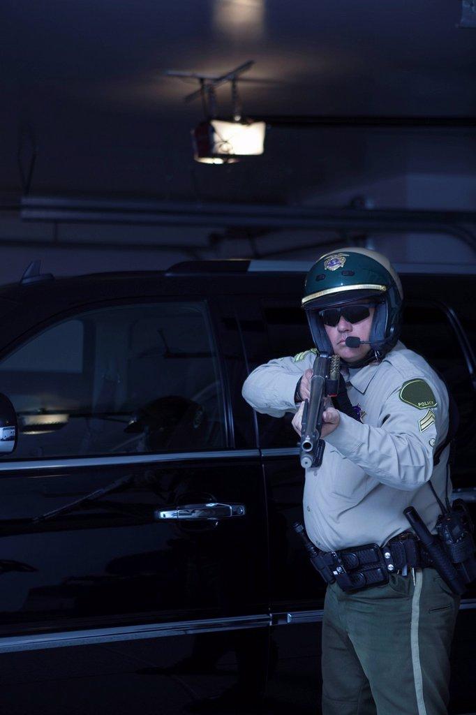Nightwatch patrolman aims rifle : Stock Photo