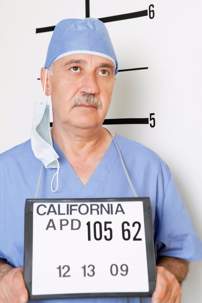 Mug shot of senior male surgeon : Stock Photo