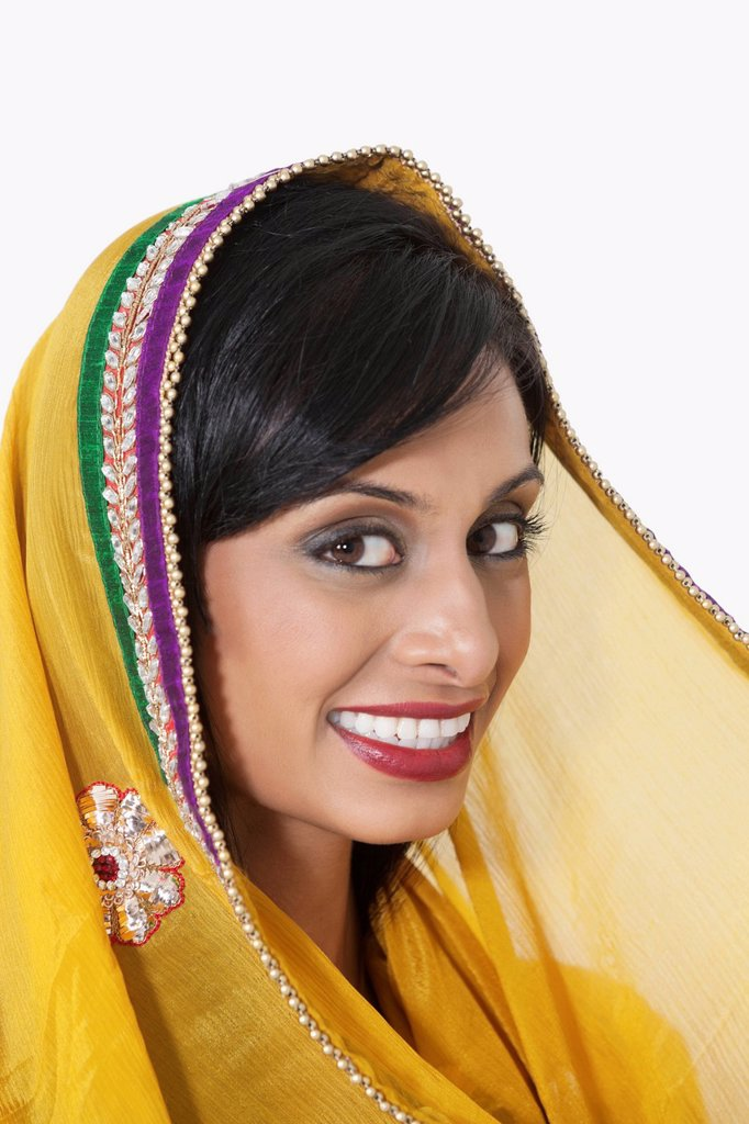 Close_up portrait of Indian woman with yellow dupatta over white background : Stock Photo