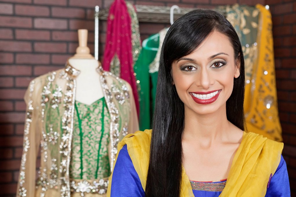 Stock Photo: 1654R-51291 Portrait of a beautiful Indian female dressmaker smiling