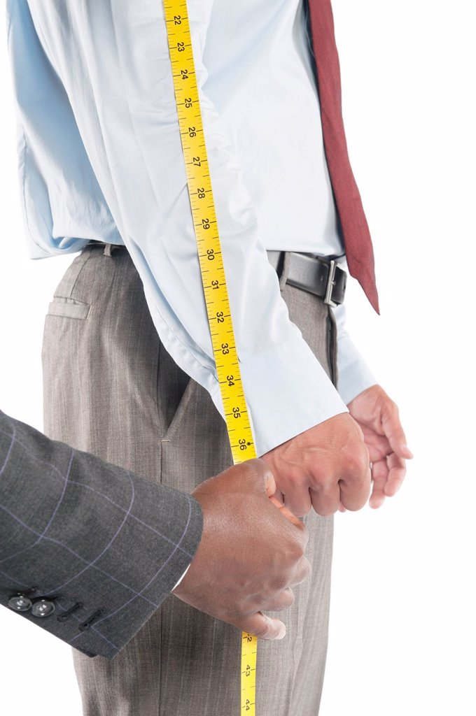 Tailor measuring shirt´s sleeve : Stock Photo