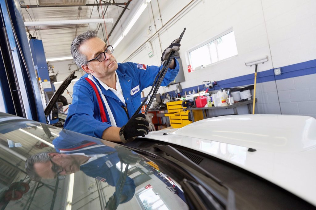 Stock Photo: 1654R-51988 Senior mechanic working on windshield wipers