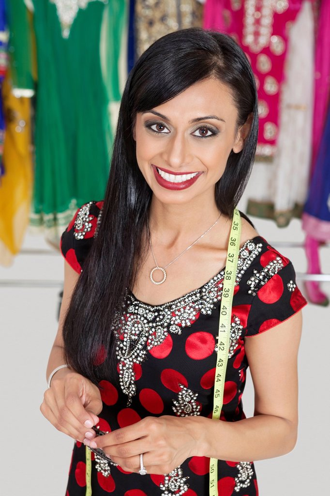 Portrait of beautiful Indian female tailor smiling : Stock Photo